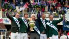 Chef d'Equipe Robert Splaine with The Furusiyya FEI Nations Cup as Team Ireland celebrate earlier this month. Photograph: Ryan Byrne/Inpho