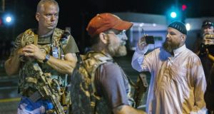 Members of the Oath Keepers in Ferguson on Tuesday morning. Photograph: Lucas Jackson/Reuters