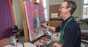 Mick O'Dea at work on his portrait of actor Barry McGovern