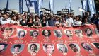 Members of Turkey's pro-Kurdish People's Democracy Party hold a banner with pictures of Suruc bomb victims. Photograph: Ozan Kose/AFP/Getty Images