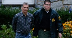 Vitaly Korchevsky is escorted in handcuffs from his home by agents from the Federal Bureau of Investigation (FBI) in Glen Mills, Pennsylvania. Photograph: Peter Foley/Bloomberg