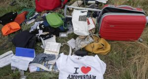 Personal belongings and luggage at the crash site of Malaysia Airlines flight MH17. Investigators have met to prepare their final report, due in October. Photograph: EPA/Anastasia Vlasov
