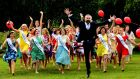 Rose of Tralee compere Dáithí Ó Sé  enjoys the event's launch with contestants at RTÉ. Photograph: Cyril Byrne
