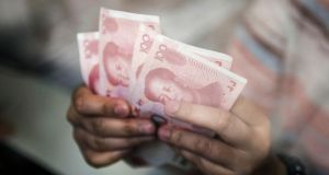 China rattled global markets this week by devaluing its currency – the yuan. Photo: Bloomberg