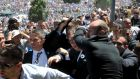 Bodyguards protect Serbia's prime minister Aleksandar Vucic during unrest at a ceremony marking the 20th anniversary of the Srebrenica massacre on July 11th. Photograph: Ivan Sebalj/Avaz/Reuters
