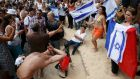 People gather with Israeli and French flags on an artificial sand beach at Paris Plages to  support the Tel Aviv on Seine event in Paris, France, August 13th, 2015. Photograph: Pascal Rossignol/Reuters