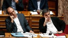 George Stathakis, Greece's economy minister, and finance minister Euclid Tsakalotos, await the vote in parliament: in the last two bailout-related parliamentary votes, a quarter of Syriza MPs withheld their support from the government. Photograph: Yorgos Karahalis/Bloomberg