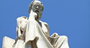 "A statue of Socrates in Athens: the philosopher  was a ""midwife"" to the truth. Teachers must interrogate pupils' standpoints and create critical thinking"