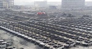 Vehicles burnt in Tianjin's warehouse explosion on August 14th. Photograph: ChinaFotoPress/Getty Images