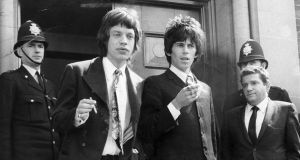 Mick Jagger and Keith Richards leaving court. Photograph: Daily Mail Syndication