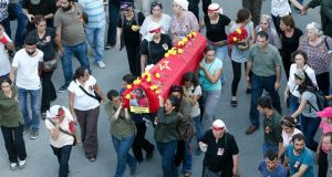 "Mourners carry the coffin of Günay Özarslann, who was killed by Turkish police in  Istanbul in an anti-terror operation on July 24th. 'Günay ...  wasn't married – she was in love with her revolutionary aspirations,"" says her elder sister. Photograph: Sedat Suna/EPA"