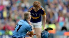 Tipperary's James Quigley consoles Dublin's Gavin King after his side's All-Ireland minor hurling semi-final win. Photograph: Inpho