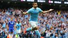 Sergio Aguero's magic opener set Manchester City on their way to a 3-0 win over champions Chelsea. Photograph: Getty