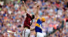 Tipperary's Seamus Callanan wins the ball ahead of Padraig Mannion of Galway to score his sides second goal. Photograph: James Crombie/Inpho