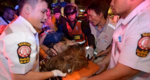 Thai rescue workers transport an injured person after a bomb exploded outside a religious shrine in central Bangkok late on Monday. Photograph: Getty Images