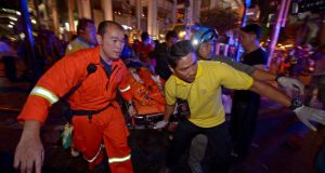 Thai rescue workers carry an injured person after a bomb exploded outside a religious shrine in central Bangkok late on Monday. Photograph: Getty Images