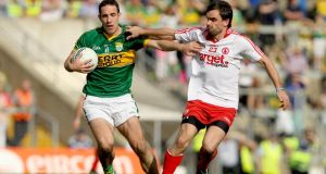Tyrone's Ryan McMenamin in action against Kerry's Declan O'Sullivan during an All-Ireland qualifier match in 2012. Photograph: James Crombie/Inpho