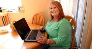Stefani Howlett at home with her laptop in Dublin.  Photograph: Cyril Byrne