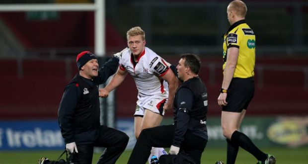 Ulster's Stuart Olding leaves the field after a head injury sustained against Munster at Thomond Park in last season's Pro12 competition. Photograph: James Crombie