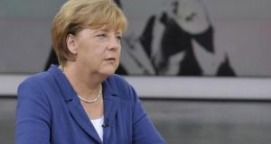 Angela Merkel: 'The issue of asylum could be the next major European project, in which we show whether we are really able to take joint action,' she told ZDF public television. Photograph: Jürgen Detmers/AFP/Getty Images