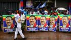 Supporters hold posters of the former Sri Lankan president and parliamentary candidate Mahinda Rajapakse  at the end of voting in the general election yesterday in Colombo, Sri Lanka. Photograph Buddhika Weerasinghe/Getty Images
