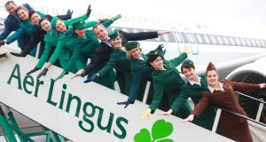 Aer Lingus unveils a new retro painted aircraft in the former 1960's Irish International livery, to mark its 75th anniversary celebrations in 2011. Cabin crew modelled vintage uniforms, from each decade beginning 1945 through to the current Aer Lingus uniform by acclaimed designer, Louise kennedy. Pictured were crew members Deborah McGuirk, Donna Murray, Anna Moore, Paula Lawlor, Muriel Cooke, Jane Curtain, Aisling Rendall, Anna Cole, Fiona Scullion, Chaoilfhionn Ginnity, Mark Tinney with with Christoph Mueller (centre) CEO Aer Lingus. (Photograph: Jason Clarke Photography)