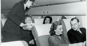 Service onboard a transatlantic Aer lingus flight in the 1950s. The airline first started  a route from Dublin and Shannon to New York in 1958.