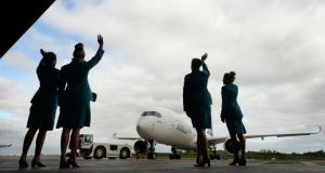 Aer Lingus staff, Fiona Tracey, Sorcha O'Rourke, Grainne Kelly and Lydia Worrell, welcome the arrival of first Aer Cap Airbus A350 at Hanger 6 Dublin Airport in July 2015. (Photograph: Dara Mac Dónaill / The Irish Times)