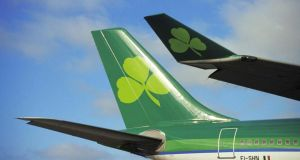 Aer Lingus will continue to fly with a shamrock on its tail but it will no longer have an Irish owner as it joins the British-Spanish group IAG.