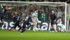 Malmo's Jo Inge Berget (second right) scores his side's second goal deep into injury time in the Uefa Champions League qualifying play-off  first leg against Celtic at Celtic Park. Photograph:   Jeff Holmes/PA
