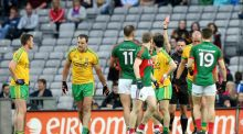Mayo's Kevin Keane is red-carded by referee David Gough for striking Donegal's Michael Murphy. The Central Hearings Committee has lifted the Mayo man's subsequent suspension. Photograph: James Crombie/Inpho