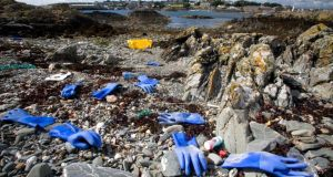 Rubber gloves and rubbish in Ardglass Harbour, Co Down. Photograph: Keep Northern Ireland Beautiful/PA Wire