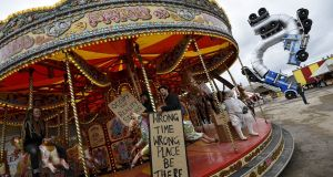 People ride a carousel at 'Dismaland', a theme park-styled art installation by British artist Banksy, at Weston-Super-Mare in southwest England, Britain, August 20th, 2015. Photograph: Toby Melville/Reuters