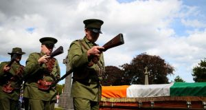 'Not to be outdone Sinn Féin staged its own elaborate re-enactment of the funeral of O'Donovan Rossa, featuring a large group of supporters wearing the uniforms of the Irish Volunteers and carrying replica guns.' Photograph:  Brian Lawless/PA