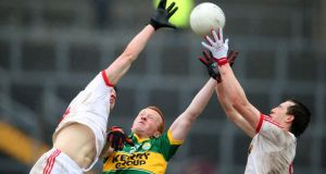 Kerry's Johnny Buckley competes with Mattie Donnelly and Colm Cavanagh of Tyrone: You'd have to imagine Kerry have enough about them to see their way to September. Photograph: Cathal Noonan/Inpho