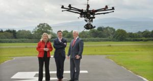Chairwoman of the Unmanned Aircraft Association of Ireland Julie Garland, Minister for Transport Paschal Donohoe and the Irish Aviation Authority's director of safety regulation Ralph James at the association's inaugural open day at Weston Airport. Photograph: Alan Betson/The Irish Times
