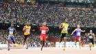 Usain Bolt eased through the 100m heats at the World Championships in Beijing. Photograph: EPA