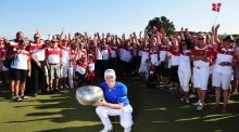 David Horsey of England holds the trophy with the volunteers after winning the Made in Denmark at Himmerland Golf & Spa Resort in Aalborg, Denmark. Photo: Stuart Franklin/Getty Images