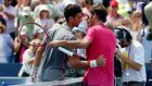 Roger Federer shakes hands with Novak Djokovic after defeating him in two sets to win the mens singles final at the Western & Southern Open at the Linder Family Tennis Center in Cincinnati, Ohio. Photo: Rob Carr/Getty Images