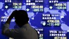 A stock quotation board outside a brokerage in Tokyo tracks plunging global indices yesterday. Photograph: Thomas Peter/Reuters