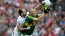 Tyrone's Justin McMahon tussles with Kieran Donaghy. Eamonn Fitzmaurice's dedcision to introduce Paul Geaney for Donaghy at half-time had the desired effect for Kerry.  Photograph: Donall Farmer/Inpho