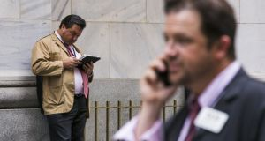 Traders outside the New York Stock Exchange. Global markets plunged again on Monday. Photograph: Lucas Jackson/Reuters