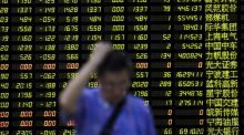 China crisis: an investor at a brokerage house in Shanghai yesterday. Photograph: Aly Song/Reuters