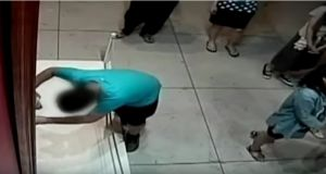 A screengrab of CCTV footage shows the boy falling into the precious painting. Photograph: Youtube