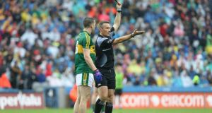 Kerry's Marc Ó Sé is shown a black card by referee Maurice Deegan who had a good match  in filthy conditions in the semi-final at Croke Park. Photogrraph: Andrew Paton/Inpho