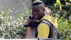 "Mario Balotelli arrives at Milanello sport center in Carnago; ""I am happy to be back. I do not have much to say because I just need to train and show what I can contribute"". Photograph: EPA"