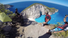 Extreme sport enthusiasts cliff jump in Greece