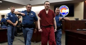 Colorado  gunman James Holmes leaves court for the last time before beginning his life sentence with no chance of parole after a hearing in Centennial, Colorado. Photograph: Reuters