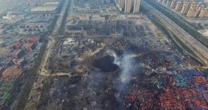 The aftermath at the scene of a massive explosion in the port city of Tianjin in China. Photograph: EPA/STR CHINA OUT