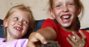 Get your girls away from the TV with a family health project. Photograph: Thinkstock